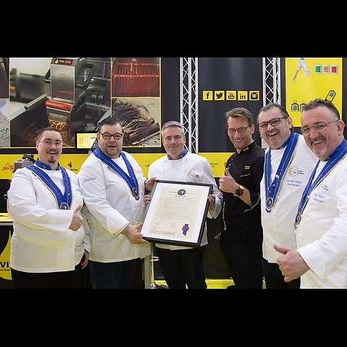 Carsten Wulf, 3. from left, gets his member certificate from Euro-Toques members and  VITO AG CEO Andreas Schmidt, middle - black chef jacket